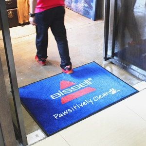 Logo mat with tufted nylon pile